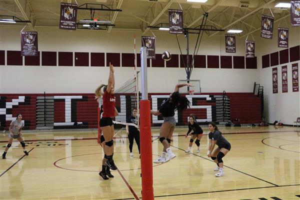 Kofa volleyball players at a practice during their 13-0 start to the season.