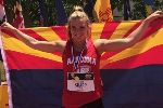 Keiley Sharp poses in front of the Arizona flag.