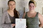 Kofa Student's Holding Letter of Participation in the Medical Congress