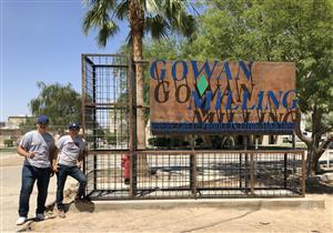 Students pose near Gowan sign