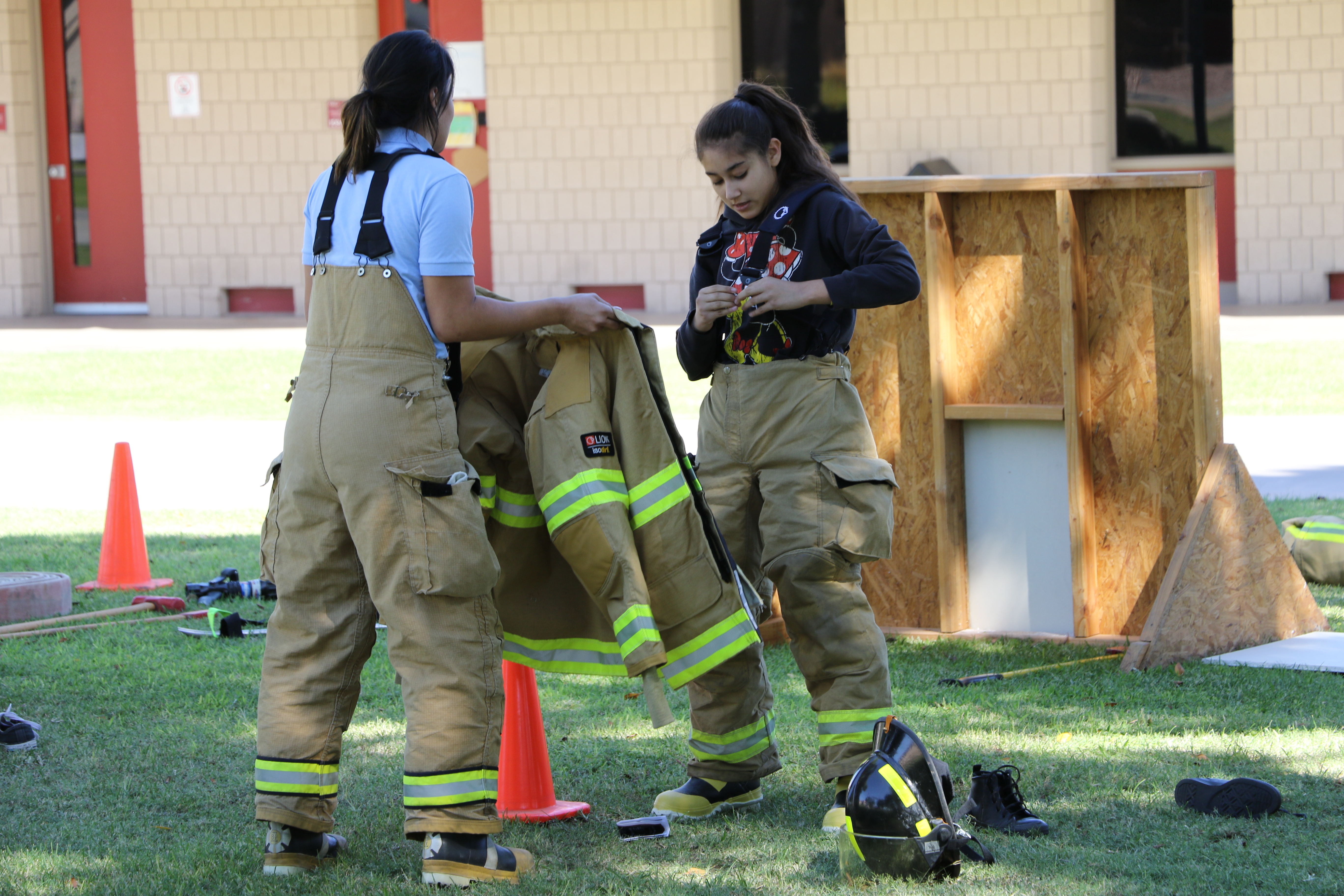 Kofa student participating in fire fighter relay at AWC