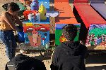 Students paint benches at Optimist Park