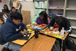 YHS AVID students create coffee sleeve messages