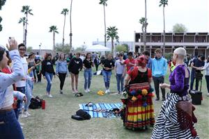 Students learn belly dancing at the AWC sustainability fair.