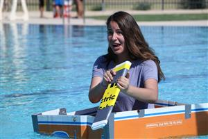 A student tests our her boat during the Float Your Boat challenge