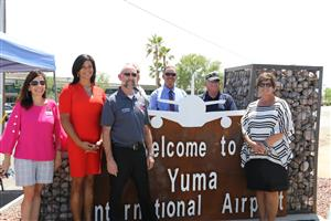 Guests unveil new airport sign