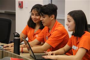 Three students work on their computer at CTE Leader Training