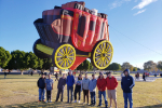 Students pose in front of Wells Fargo balloon.