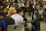 Student at YYTH listening to keynote address