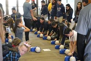 Middle school students learn how to provide CPR