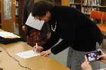 Gina Thompson signs her contract to officially become the new YUHSD Superintendent.