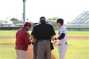 Richy Leon and Nick Johnson meet at homeplate