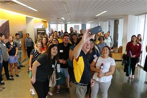 Dr. Corr takes a selfie with new teachers