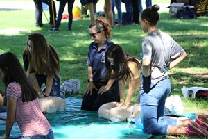Students practice CPR at Non-Traditional Career Conference.