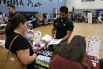 Representative from NMSU talking to a parent at Gila Ridge