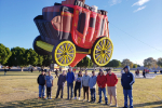 Students pose with Wells Fargo balloon