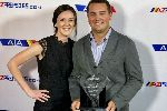 Corey Semler shows his award off alongside his wife, Taylor (left).