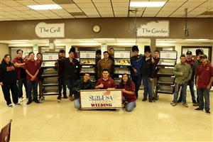 Kofa welders pose with share carts