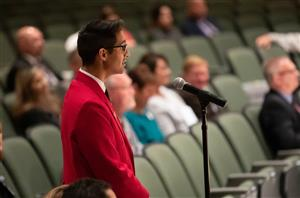 Miguel Nunez talks on mic. Photo by Andrea Chavez, SLHS