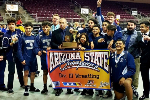 YHS wrestling team posing with state title banner