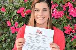 Clara Haynes poses with letter of intent to Biola University.