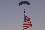 Jay Stokes skydiving with flag