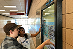 Students at GRHS use the new digital kiosk.
